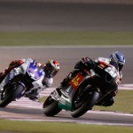 Michele Pirro a Doha, dietro di lui Jorge Lorenzo
